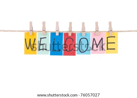 Welcome, paper words card hang by wooden peg - stock photo