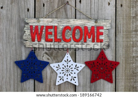 Welcome sign with red, white and blue stars - stock photo
