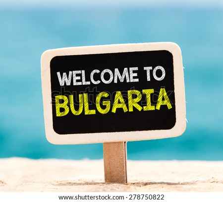 Welcome to Bulgaria on chalkboard. Welcome to Bulgaria text written on chalkboard, on beach - stock photo