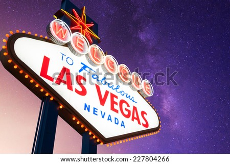 Welcome to Fabulous Las Vegas Neon Sign With Galaxy in the Background - stock photo