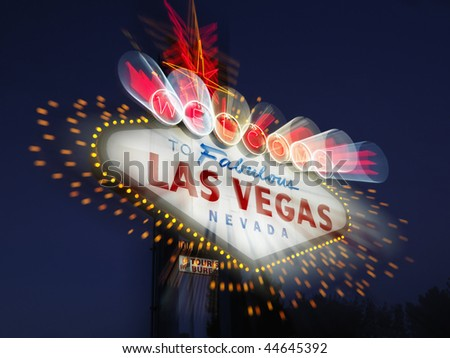 Welcome to Fabulous Las Vegas Nevada sign with motion zoom blur at night. Horizontally framed shot. - stock photo