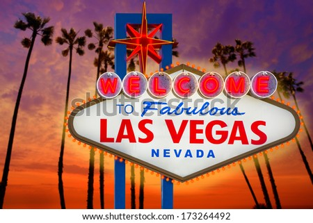 Welcome to Fabulous Las Vegas sign sunset with palm trees Nevada photo mount and illustration - stock photo