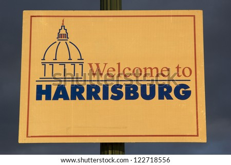 Welcome to Harrisburg sign seen during sunset - stock photo