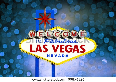 Welcome to Las Vegas Sign with blue bokeh of light in the background - stock photo