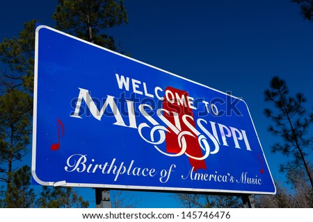 Welcome to Mississippi road sign with a blue sky background - stock photo