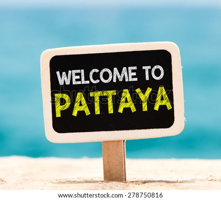Welcome to Pattaya on chalkboard. Welcome to Pattaya text written on chalkboard, on beach - stock photo