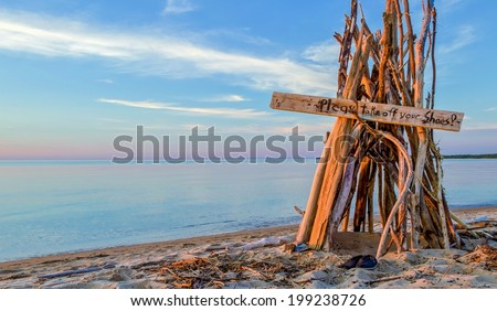 Welcome To The Beach.  Driftwood beach hut with handwritten welcome sign. Port Crescent State Park. Port Austin, Michigan.  - stock photo