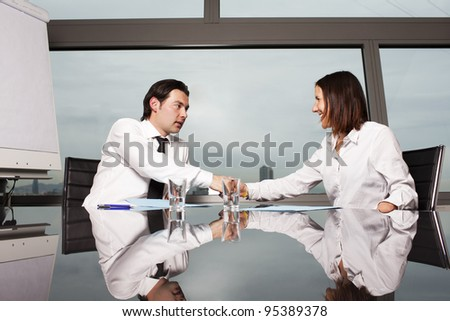 Welcome to the new job shaking hands - stock photo