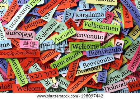 welcome  Word Cloud  printed on  paper on blue font - stock photo