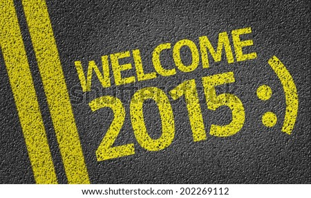 Welcome 2015 written on the road - stock photo
