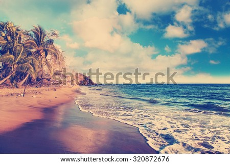 Welcoming yellow sand of winter ocean beach in Maui, Hawaii - stock photo