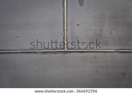 Welded stainless steel - stock photo