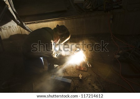 Welder and Tools on Building Site - stock photo