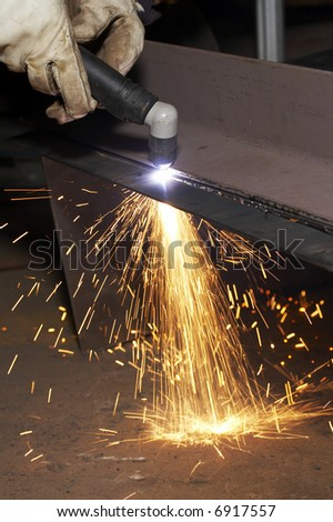 welder at shipyard working on steel project
