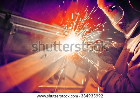 Welder in the mask at work - stock photo