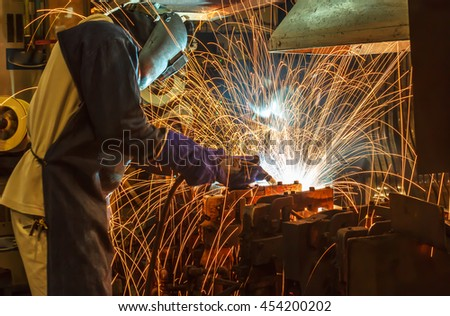 welder Industrial movement welding automotive part in factory
