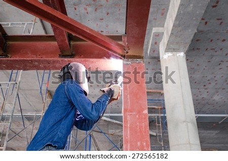 Welder man welding metal and sparks ,Mask and gloves for protection. - stock photo