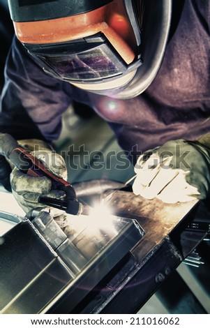 Welder to weld aluminum materials. - stock photo