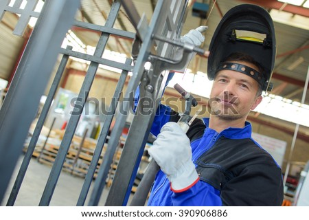 welder with a steel frame - stock photo
