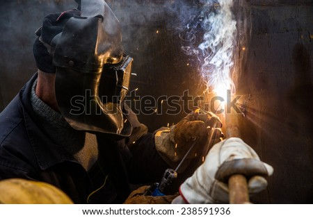 Welder with full protection welding - stock photo