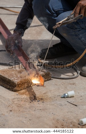 Welder working a welding metal. Not wearing glove