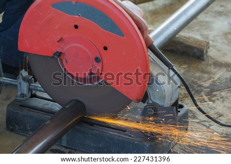 Welders cutting pipe to be used for the connection - stock photo