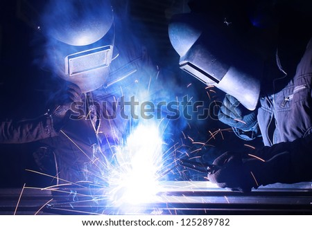 Welders team. Construction and manufacturing - stock photo