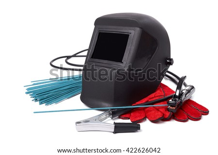 Welding equipment isolated on a white background, welding mask, leather gloves, welding electrodes, high-voltage wires with clips, set of accessories for arc welding. - stock photo