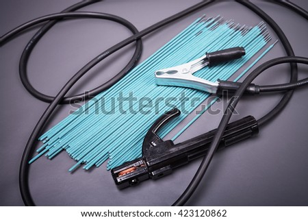 Welding equipment, welding electrodes, high-voltage wires with clips, set of accessories for arc welding. - stock photo