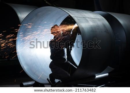 welding in the steel tube - stock photo