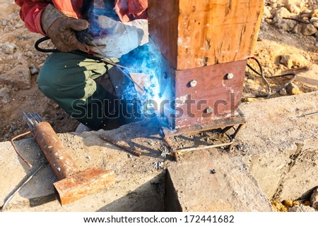 welding metal and wood by electrode with bright electric arc - stock photo