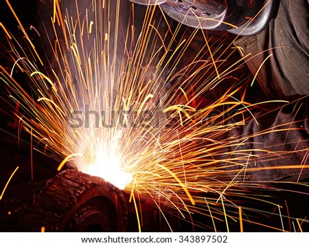 Welding sparks and worker