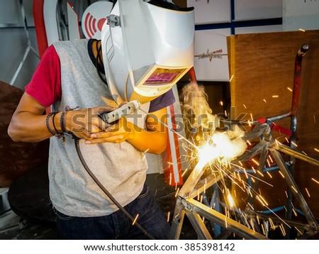 Welding steel in factory - stock photo
