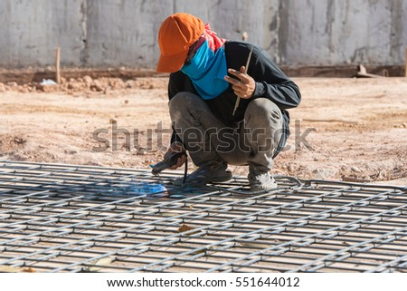 Welding steel structure in construction site