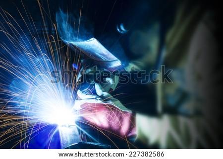 Welding steel structures - stock photo