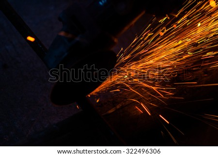 welding steel with sparks lighting - stock photo