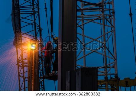 Welding steel workers - stock photo
