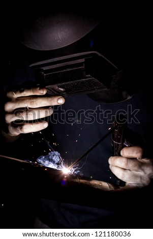 Welding with sparks. - stock photo