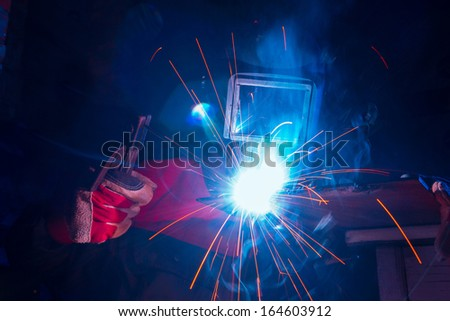 Welding with sparks - stock photo