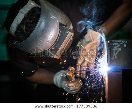 Welding work with worker by hand