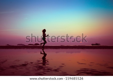 well being or sport background, woman silhouette on the beach - stock photo