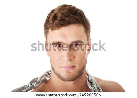 Well build young male model with chains over his neck. - stock photo