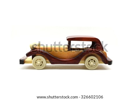 Well crafted colorful wooden toy car isolated on white with lot of empty space for message