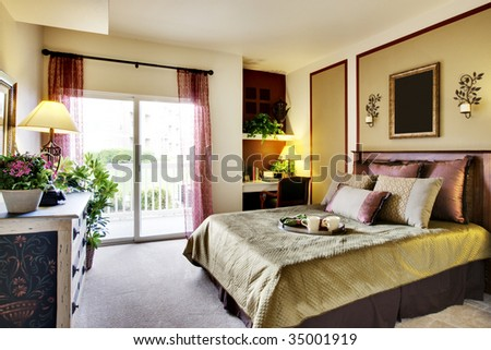 Well decorated apartment bedroom - stock photo