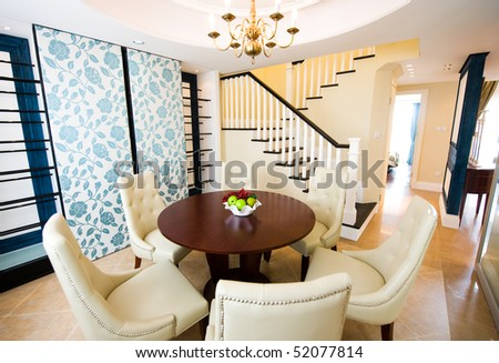 Well decorated formal dining room in a luxury home.
