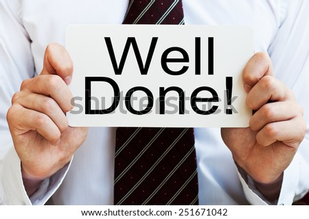 Well done! written on a card in businessman's hands - stock photo
