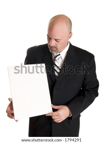 well dressed businessman holding a blank sign, ready for your copy. - stock photo