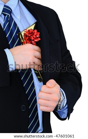Well-dressed businessman is hiding a gift under his coat - stock photo