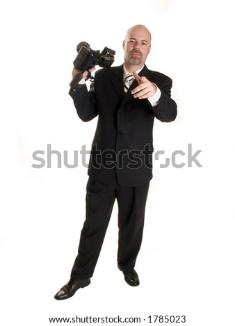 well dressed wedding photographer, pointing at the camera.  Isolated on white. - stock photo
