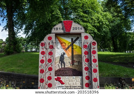 Well dressing in Buxton, Derbyshire celebrating the great war centennial. A summer tradition in which wells, springs or other water sources are decorated with designs created from flower petals. - stock photo